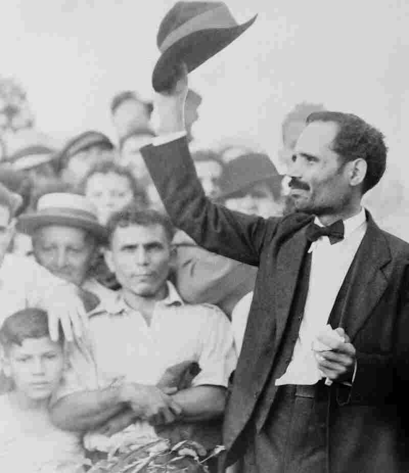 Pedro Albizu Campos, right, waves his hat in this undated photo. The Puerto Rican Nationalist Party leader called for armed uprisings in several cities in 1950.