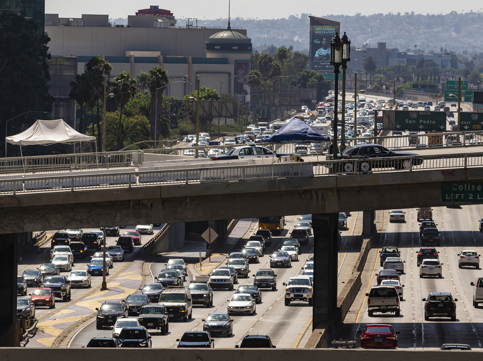 A view over the Harbor Freeway in Los Angeles on Tuesday. President Trump says his administration will revoke a waiver that allows California to set its own vehicle emissions standards. (Damian Dovarganes/AP)