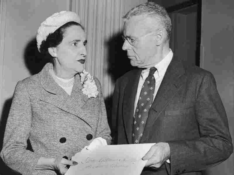 Dr. Cornelius P. Rhoads is presented with a $10,000 check for cancer research by Dorothy Shaver, president of Lord & Taylor department store, during the 20th Lord & Taylor Award Luncheon at the Waldorf-Astoria Hotel, New York City, 1950s.