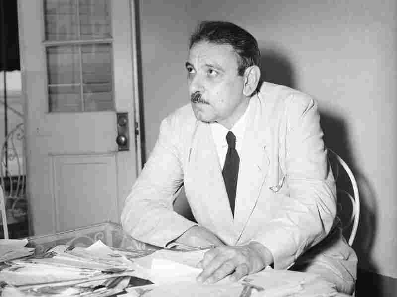 Governor Luis Munoz Marin, first elected governor of Puerto Rico, looking over hundreds of cablegrams congratulating him on his escape after nationalists attempted to assassinate him.