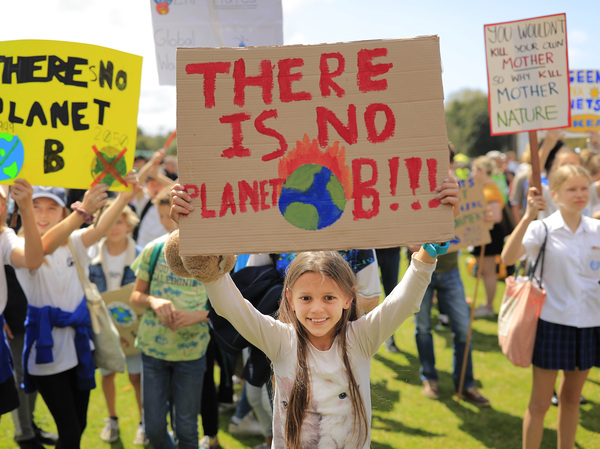Thousands of school students join protesters in a Climate Strike rally on Friday in Sydney, Australia. Rallies held across Australia are part of a global mass day of action demanding action on the climate crisis.