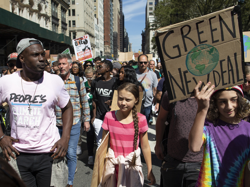 Greta Thunberg, the 16-year-old leader of a global protest against inaction on climate change, marched at a rally in New York City Friday. Around the world, millions of other people joined her. (Eduardo Munoz Alvarez/AP)