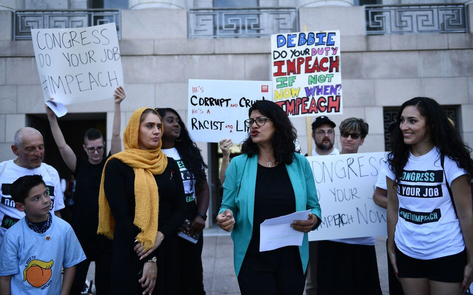 Rep. Rashida Tlaib, D-Mich., joins activists asking for impeachment of President Trump on Capitol Hill on Monday. (Brendan Smialowski/AFP/Getty Images)