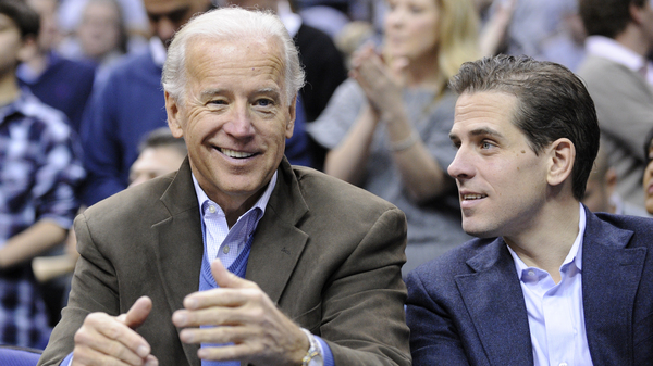 Then-Vice President Joe Biden and his son, Hunter Biden, attend a basketball game in Washington in 2010. Joe Biden frequently dealt with the Ukrainian government and pressed the government to deal with corruption issues. At the same time, Hunter Biden was on the board of a leading gas company in Ukraine. President Trump and some of his supporters have called for an investigation.