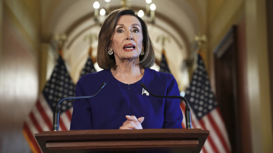 House Speaker Nancy Pelosi reads a statement announcing a formal impeachment inquiry into President Trump on Tuesday. (Andrew Harnik/AP)