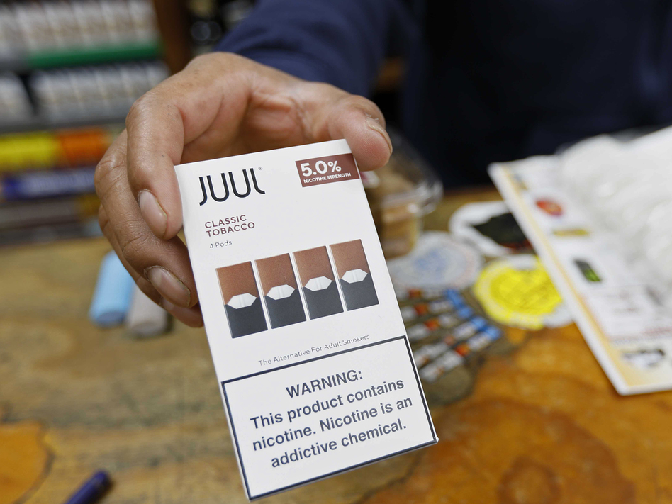 Juul announced that its CEO is stepping down and the company will stop advertising its popular vaping products. The announcements come as regulators work on new rules to curb the use of flavored vaping products among young adults. (Samantha Maldonado/AP)