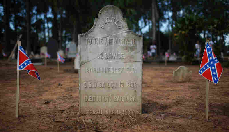 The grave of a U.S. settler is marked with Confederate flags in the Americanos Cemetery in Santa Barbara d'Oeste, Brazil.