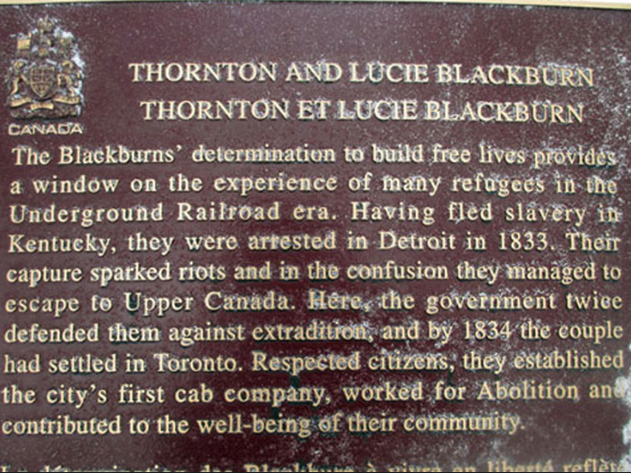 A commemorative plaque by the Historic Sites and Monuments Board of Canada remembering Thornton and Ruthy/Lucie Blackburn