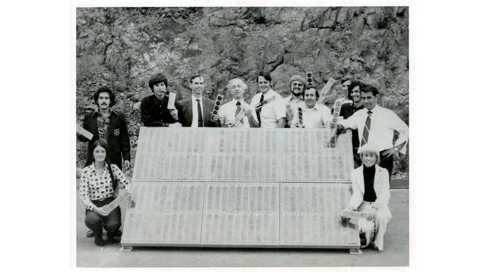 Elliot Berman with his team at Solar Power Corporation outside their office and manufacturing facility in Braintree, Mass., in 1973. John Perlin, author of <em>Let it Shine: The 6,000-Year Story of Solar Energy</em>, credits Berman with planting the flag of solar photovoltaics throughout the world. (Solar Power Corporation via John Perlin)