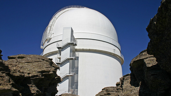 A team of scientists used a telescope at the Calar Alto Observatory in Spain to detect a gas giant orbiting a tiny red star some 30 light-years from Earth.