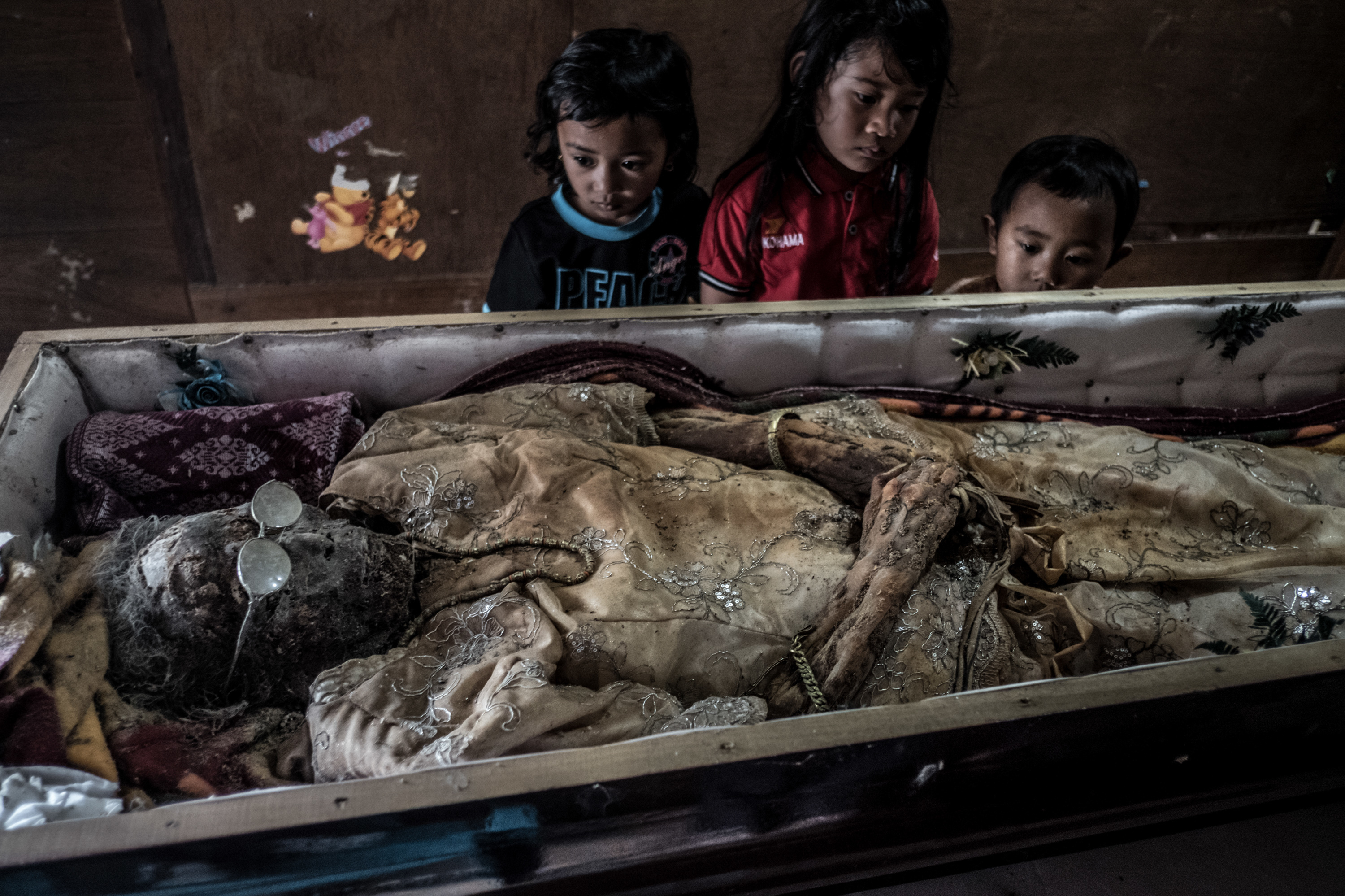 PHOTOS: The Dead Live With Their Loved Ones On This Indonesian Island