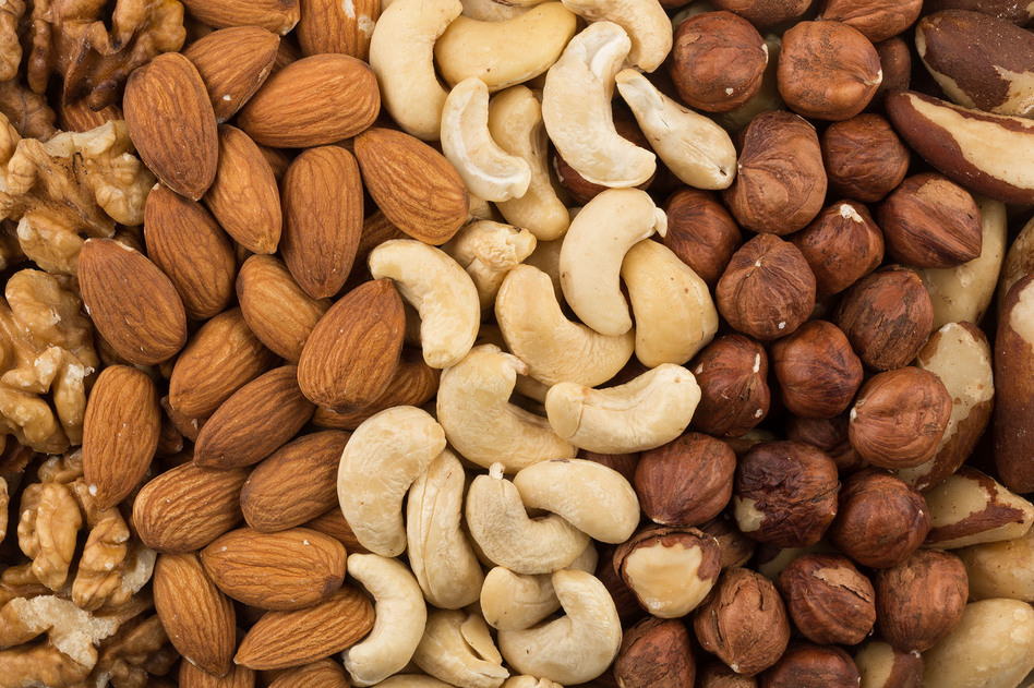 U.S. adults put on about a pound a year on average. But people who had a regular nut-snacking habit put on less weight and had a lower risk of becoming obese over time, a new study finds. (R.Tsubin/Getty Images)
