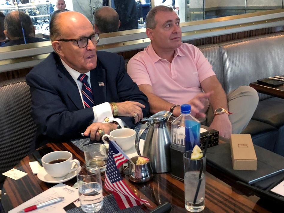 President Trump's personal lawyer Rudy Giuliani has coffee with Ukrainian-American businessman Lev Parnas at the Trump International Hotel in Washington on Sept. 20. (Aram Roston/Reuters)