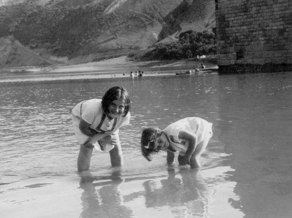 Renia Spiegel (left) and her younger sister, now known as Elizabeth Bellak, wade in the Dniester River around 1935. The photo can be seen on the cover of the published edition of Renia's Diary.
