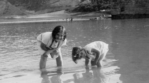 Renia Spiegel (left) and her younger sister, now known as Elizabeth Bellak, wade in the Dniester River around 1935. The photo can be seen on the cover of the published edition of Renia