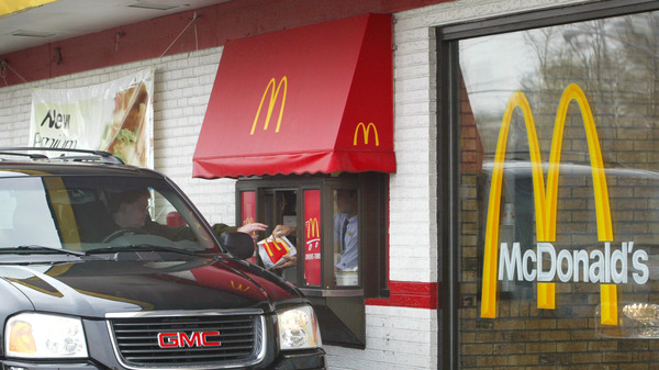 More cities are passing legislation to ban the construction of drive-through windows in an attempt to curb emissions, reduce litter and improve pedestrian safety.