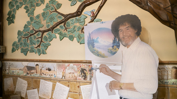 A life size cut out of Bob Ross stands up against the wall where the historical tree of the Franklin Park Arts Center is painted. Bob Ross Inc. is located in Herndon, Va., which is only 27 miles from the exhibit. According to managing director, Elizabeth Bracey, the exhibit was intentionally kept close to headquarters.