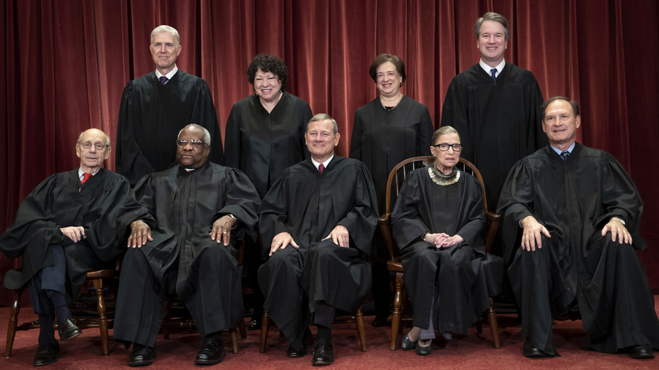 The Supreme Court justices, pictured in November 2018, start a new term on Monday. (J. Scott Applewhite/AP)