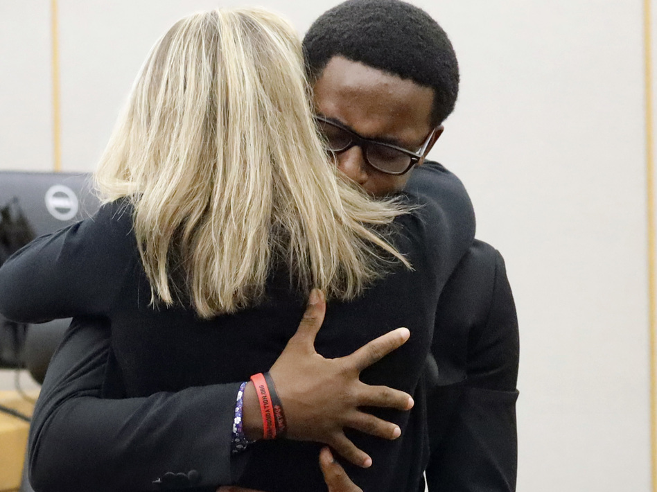 Botham Jean's younger brother, Brandt Jean, hugs former Dallas police officer Amber Guyger after delivering his victim-impact statement. Guyger was convicted for Botham Jean's murder on Tuesday and was sentenced to 10 years in prison on Wednesday. (Tom Fox/The Dallas Morning News via AP, Pool)