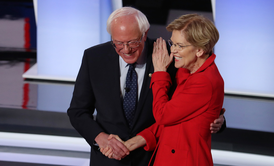 Sens. Bernie Sanders of Vermont and Elizabeth Warren of Massachusetts greet each other at the start of the Democratic presidential debate in Detroit in July. (Justin Sullivan/Getty Images)
