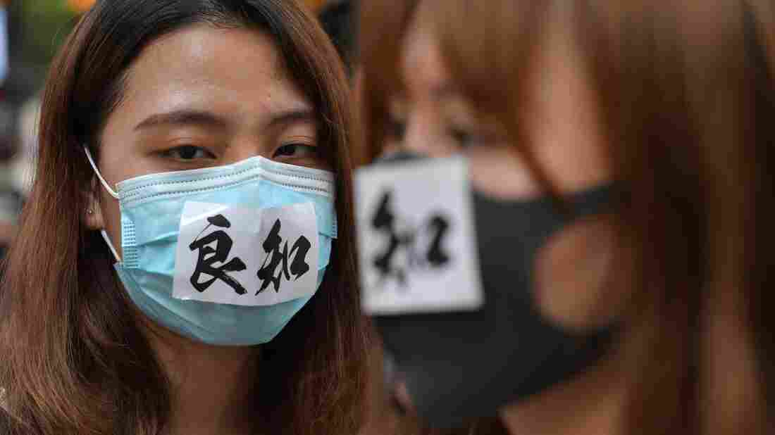 Westlake Legal Group gettyimages-1173576939_wide-9cd48d0322cf0599ef02f62713004d6f9a986f8d-s1100-c15 Hong Kong Bans Face Masks At Public Assemblies