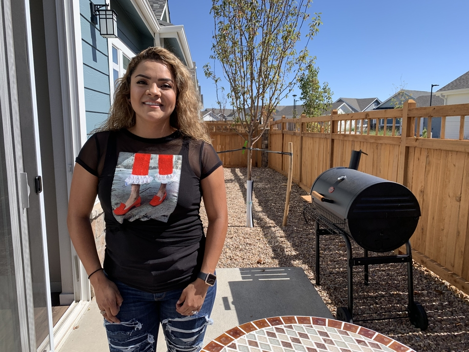 Itzel Alarcon recently moved into a rental development near Denver. She says she's renting for now because she saw relatives hurt by the housing crash and is worried that home values might drop again. (Chris Arnold/NPR)