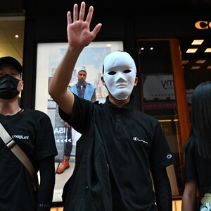 Hong Kong Protesters Defy Ban On Face Masks And Adopt A New Slogan