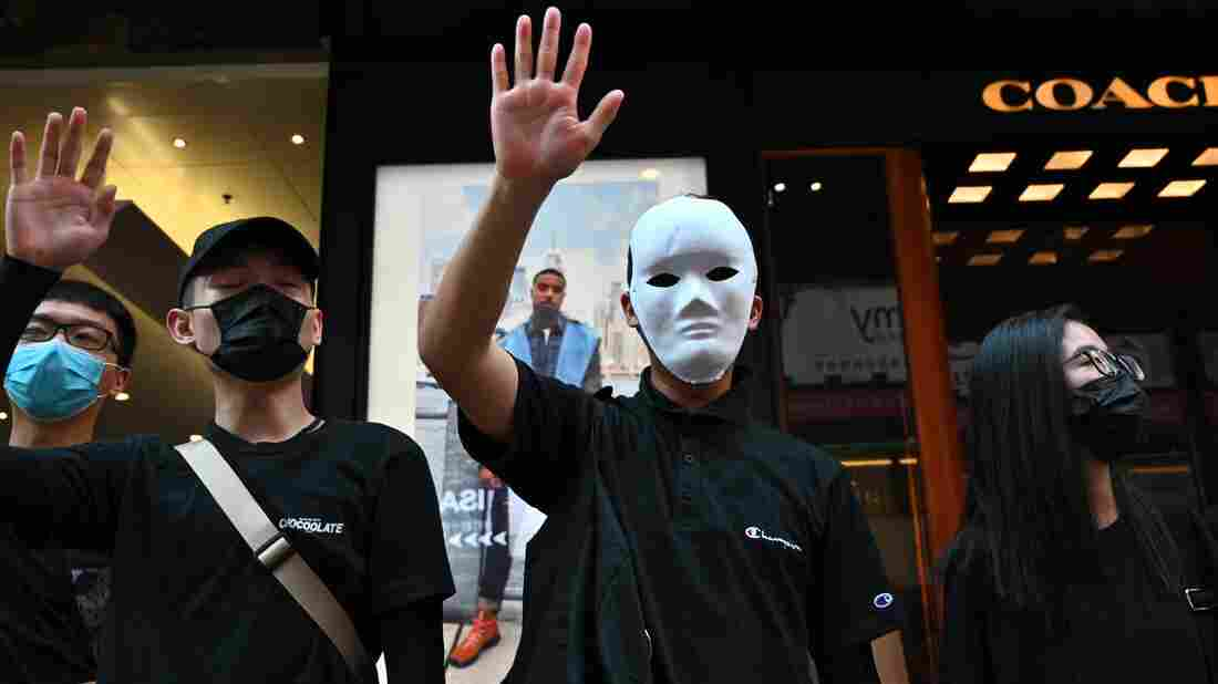 Westlake Legal Group gettyimages-1173728992_wide-6537bbe4a7a63b7d59d0b5438b64031d6078e27e-s1100-c15 Hong Kong Protesters Defy Ban On Face Masks And Adopt A New Slogan