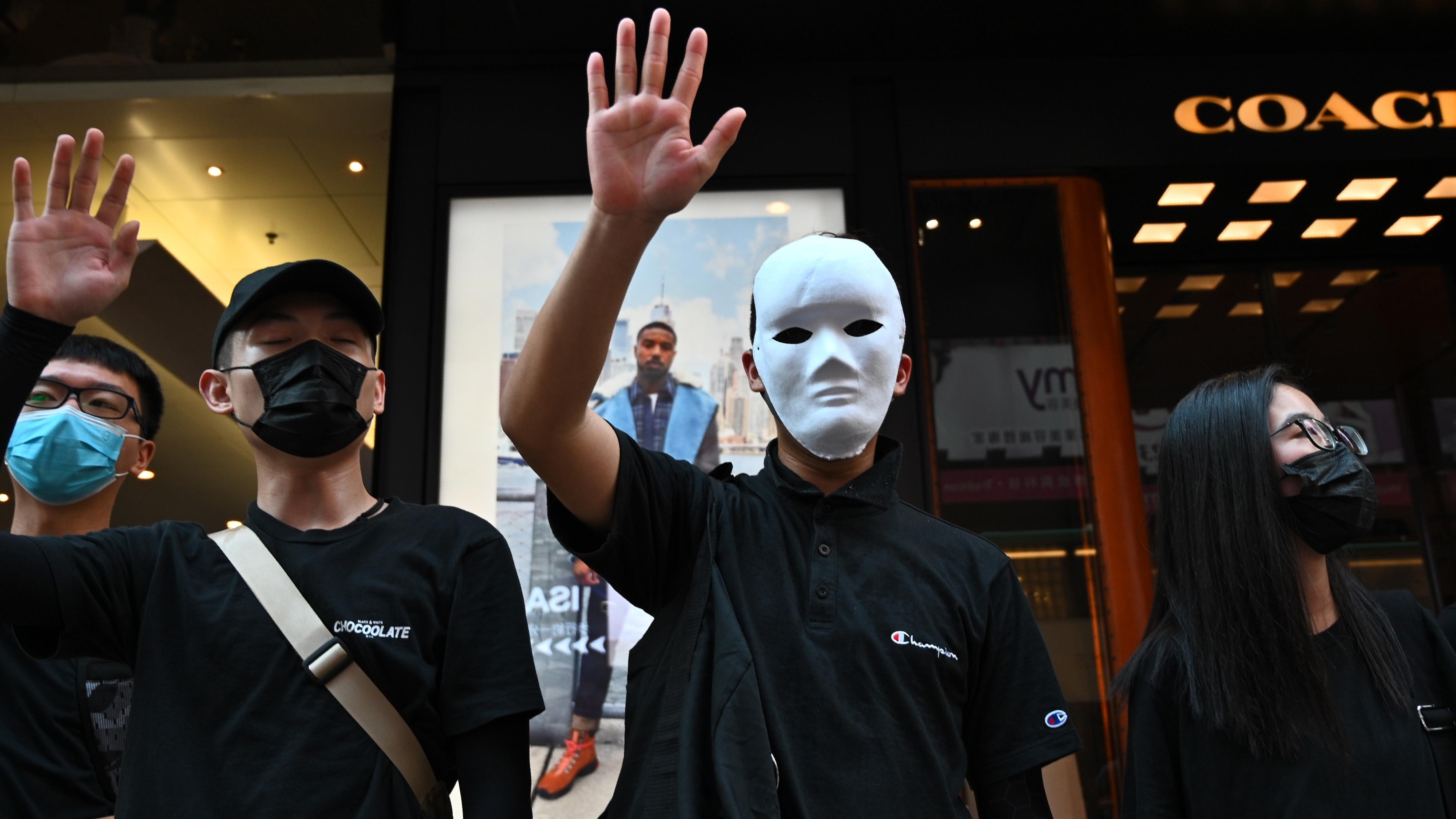 Hong Kong Protesters Defy Ban On Face Masks And Adopt A New Slogan