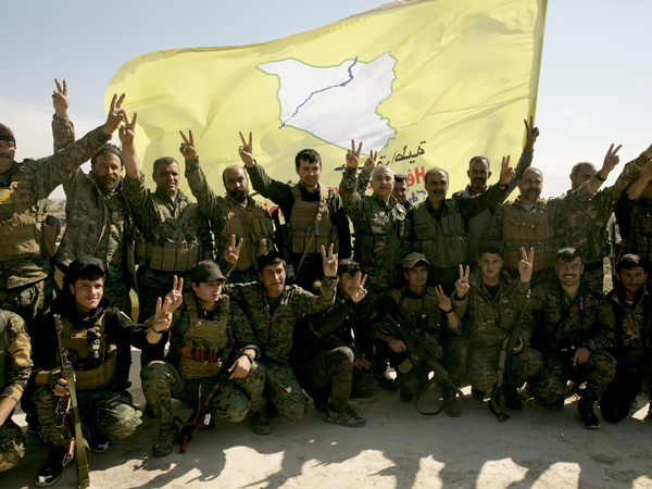 U.S.-backed Syrian Democratic Forces (SDF) fighters pose for a photo in Baghouz, Syria, after the SDF declared the area free of Islamic State militants, in March.