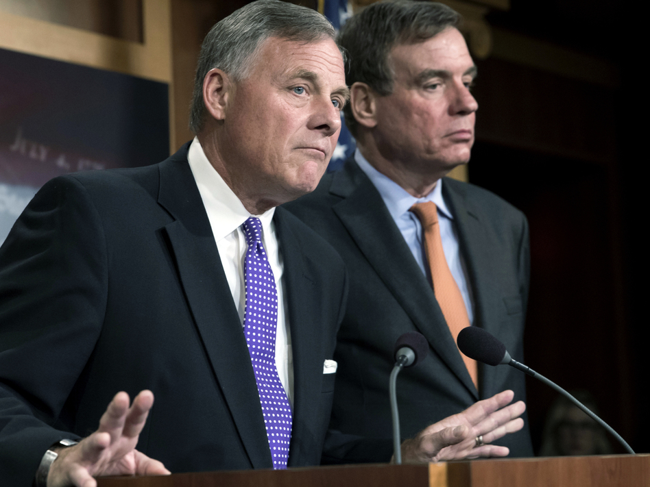 Senate Select Committee on Intelligence Chairman Richard Burr, R-N.C., (left) and Vice Chairman Mark Warner, D-Va., released a new report on how Russians used social media targeting to meddle with the 2016 election. (J. Scott Applewhite/AP)