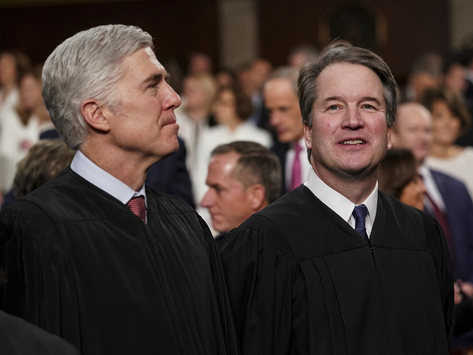 Justice Neil Gorsuch (left), with Justice Brett Kavanaugh, asked many of the key questions in Tuesday's case before the U.S. Supreme Court that centered on whether employers can fire gay or transgender workers. (Doug Mills/AP)