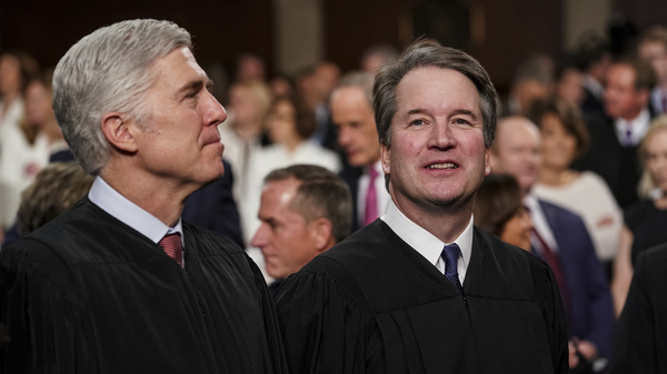 Justice Neil Gorsuch (left), with Justice Brett Kavanaugh, asked many of the key questions in Tuesday