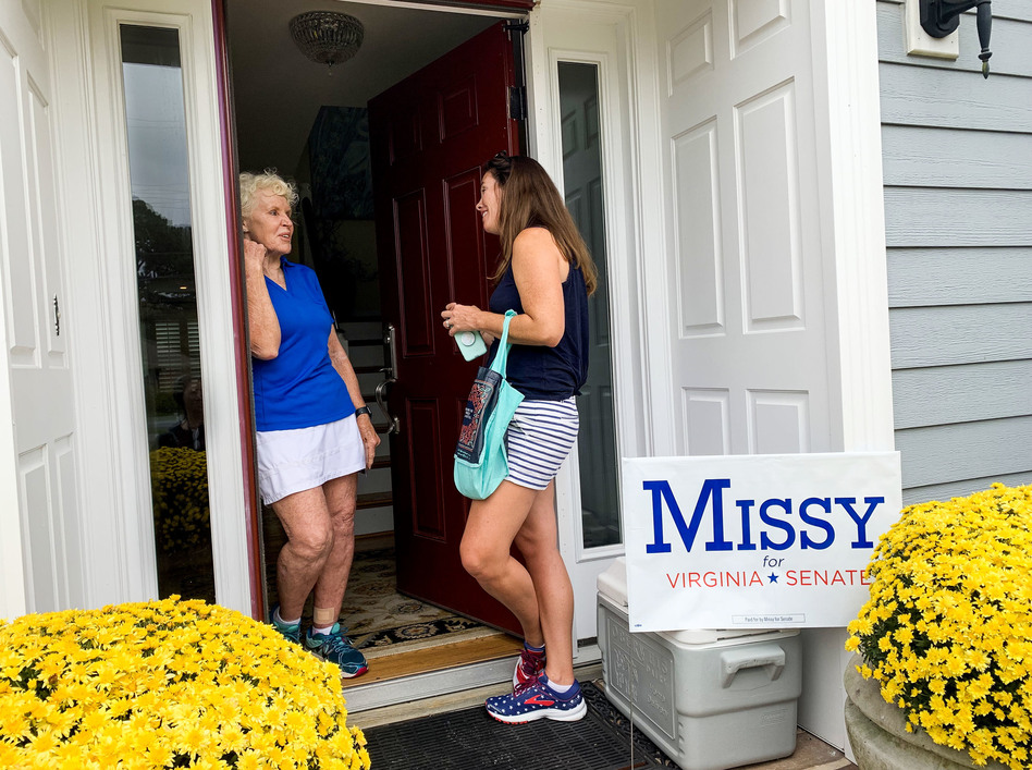 "Canvassing for votes in Virginia Beach, Democrat Missy Cotter Smasal meets voter Mildred Manger. ""It's just stupid that everybody has to have a gun,"" Manger says. ""I mean, give me a break!"" (Melissa Block/NPR)"