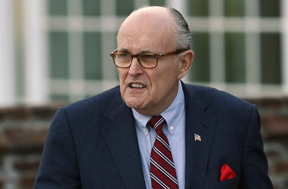 Associates of President Trump's personal lawyer Rudy Giuliani have been arrested on campaign finance charges. (Carolyn Kaster/AP)