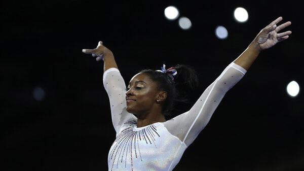 Simone Biles performs on the vault in the women's all-around final at the Gymnastics World Championships in Stuttgart, Germany.