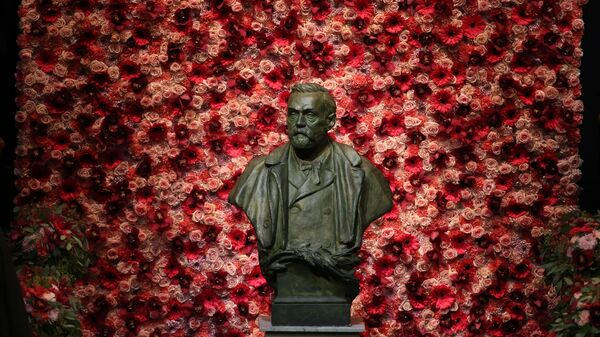 A bust of Alfred Nobel, whose last will established the Nobel Prize in literature, stands outside a 2016 ceremony in Stockholm. This year, in a break with tradition driven by scandal, two writers have been honored with the prestigious award named for the late Swedish businessman.