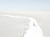 Iran's Lake Urmia has shriveled because of water mismanagement. Photographer Maximilian Mann traveled to northwest Iran to document life in the region. Here, a man walks in what used to be a river to the lake, now just salt.