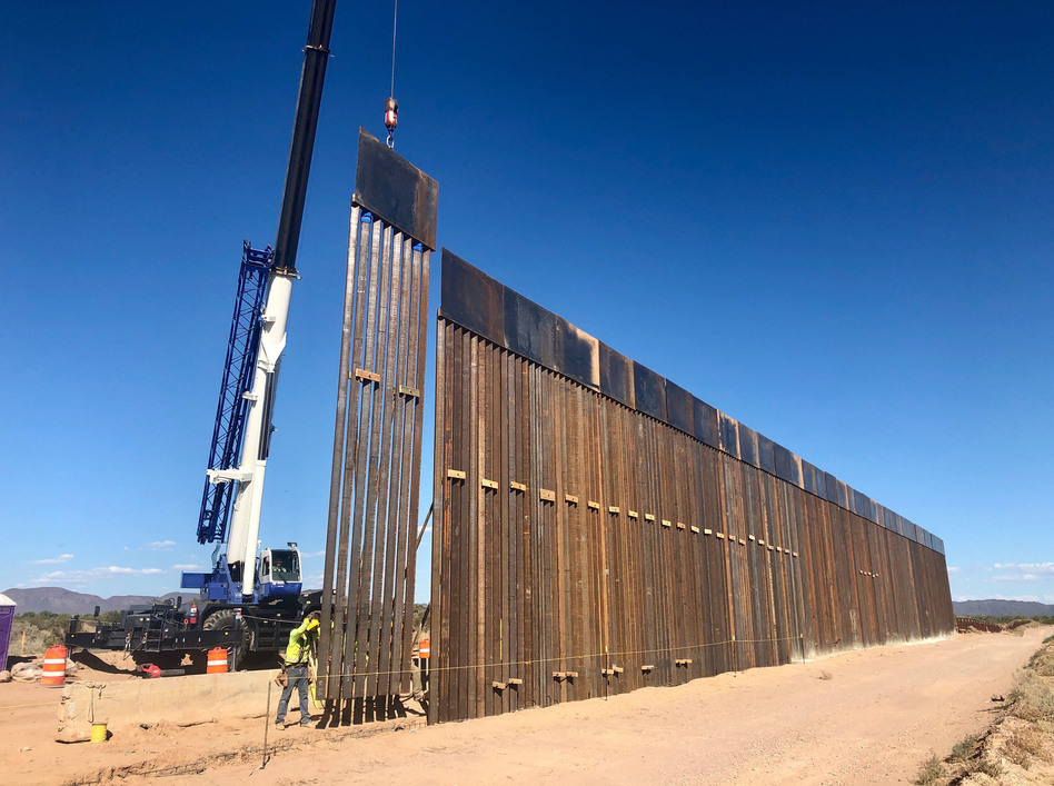 A 30-foot border barrier — as tall as a two-story building — rises from the desert near Lukeville, Ariz. (Laiken Jordahl /Center for Biological Diversity)