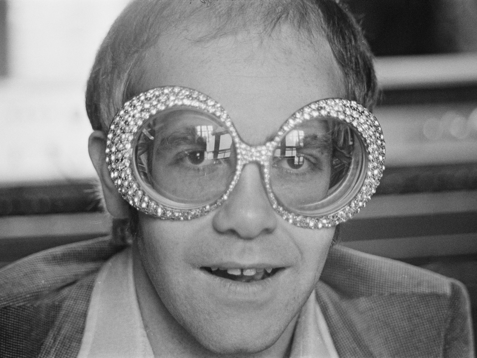 In his memoir, <em>Me</em>, British singer-songwriter Elton John, shown in 1974, shares revelations about his sexual orientation and his struggle with cocaine. (D. Morrison/Daily Express/Hulton Archive/Getty Images)