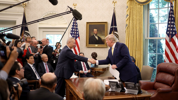 U.S. President Donald Trump shakes hands with Chinese Vice Premier Liu He in the Oval Office at the White House October 11, 2019 in Washington, DC. President Trump announced a