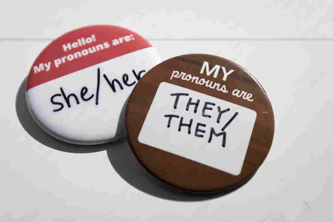 Buttons with spaces for the wearer to indicate pronouns.