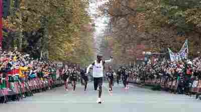 VIDEO: Eliud Kipchoge Dashes Past 2-Hour Marathon Barrier In Assisted Event