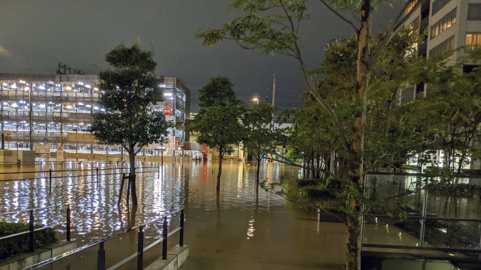 The streets in Kawasaki, near Tokyo, flooded after Typhoon Hagibis made landfall Saturday. Helicopters plucked people from their flooded homes on Sunday as rescue efforts went into full force in wide areas of Japan. (@ar_kaz/AP)