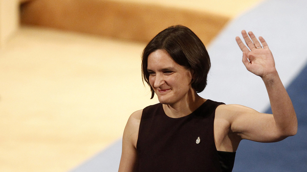 Esther Duflo of France waves after receiving the Princess of Asturias award for Social Sciences from Spain