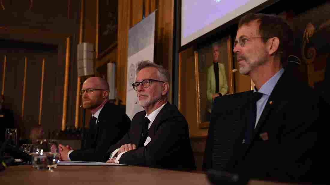 The announcement of the winners of the 2019 Nobel Prize in Economic Sciences at the Royal Swedish Academy of Sciences. (Photo by Jonathan NACKSTRAND / AFP)
