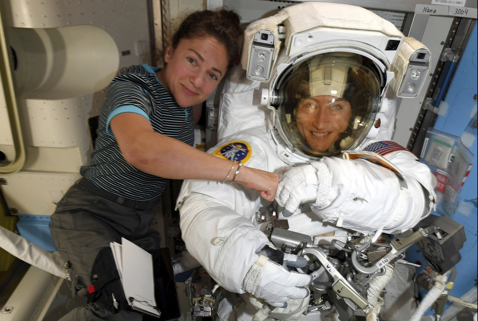 Astronauts Christina Koch (right) and Jessica Meir pose for a photo on the International Space Station on Oct. 4. NASA moved up the first all-female spacewalk because of a power system failure at the space station. (NASA via AP)