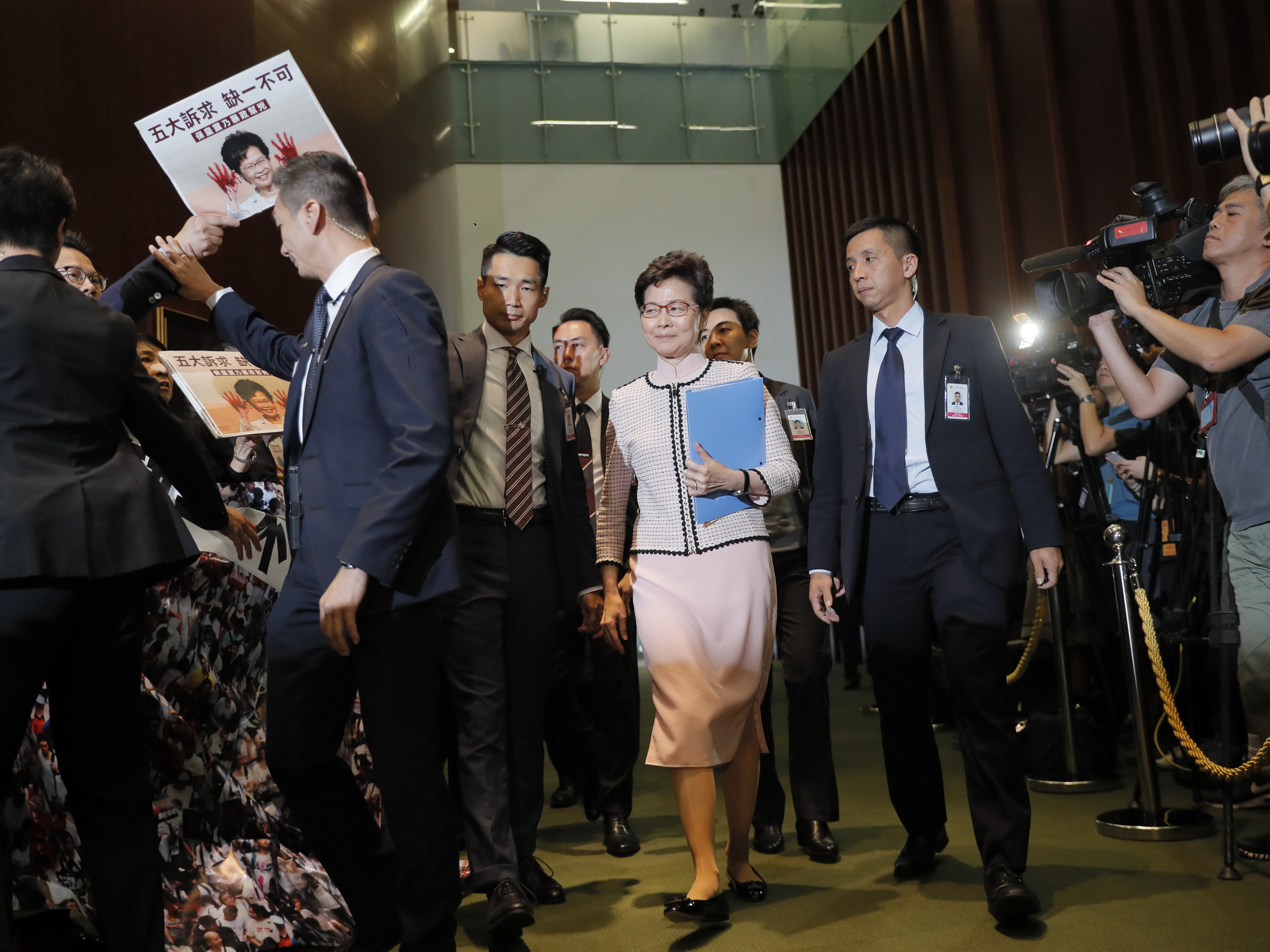 Hong Kong's Leader Driven Out Of Legislature By Raucous Pro-Democracy Lawmakers