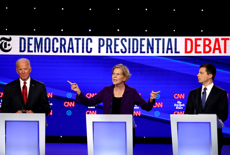 Left to right: former Vice President Joe Biden, Massuchusetts Sen. Elizabeth Warren and South Bend, Ind., Mayor Pete Buttigieg react on stage during the Democratic presidential debate at Otterbein University. (Win McNamee/Getty Images)