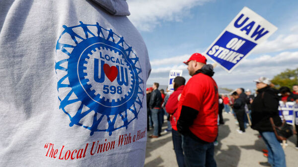 The UAW GM National Council will vote on a new tentative deal Thursday, in a potential end to the national strike that has idled GM plants. Here, union members and their families rallied near the General Motors Flint Assembly plant on Sunday.